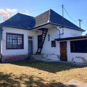 **NOVÁ CENA** Na predaj starší tehlový rodinný dom 100 m2 s garážou a pozemkom 609 m2 - Kočovce