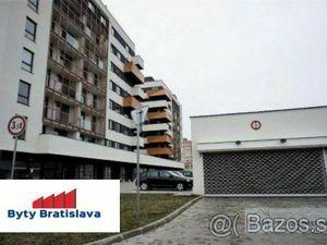 RK Byty Bratislava. Prenajmem garážové státie v novostavbe na Muchovom nám. BA V - Petržalka