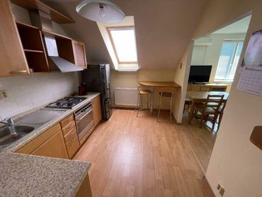 Predaj priestranného 4-izbového mezonetového bytu s garážovým státím na Južnej ulici