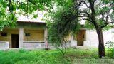 NOVÁ CENA !!Gazdovský dom s veľkým pozemkom vhodný aj na podnikanie blízko Lučenca